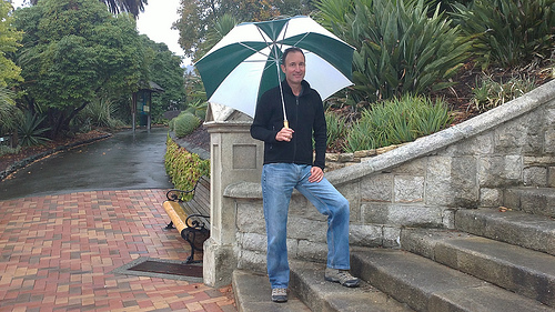 Michael with umbrella - Clothing for travel in New Zealand