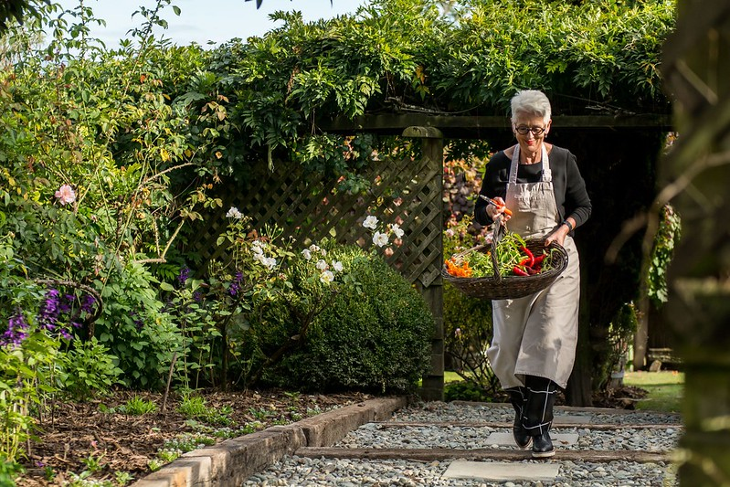 chef ali at te koi lodge garden for Slow Eco Travel in New Zealand